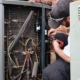 service-repair-being-done-on-a-heat-pump-hvac-syst-Kay Heating